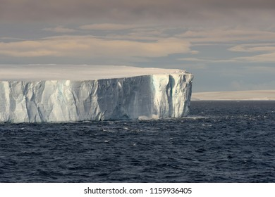 Huge Tabular Iceberg Floating In Bransfield Strait Near The Northern Tip Of The Antarctic Peninsula, Antarctica