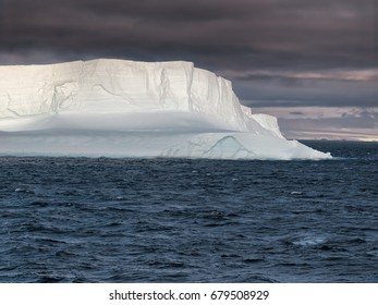 Huge Tabular Iceberg floating in Bransfield Strait at sunset,  Antarctica