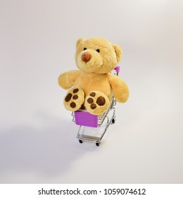 Huge teddy bear in a shopping cart, on a white background, from above, at an angle