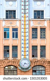 The huge thermometer on the building. Very big measuring instrument. Meteorological research. Weather change. Weather forecast concept.
