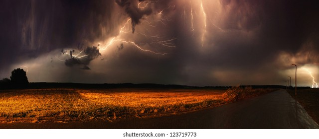 Huge thunders in a field in the evening.