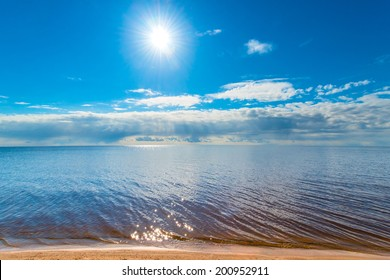 huge tranquil lake and the bright sun