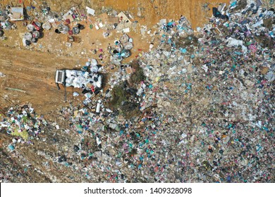 Huge trash pile Malaysia. Plastic trash sent for recycling is instead dumped in jungle