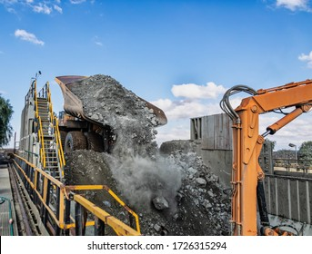 Huge truck unloading kimberlite in a crusher in an open pit diamond mine , in Botswana