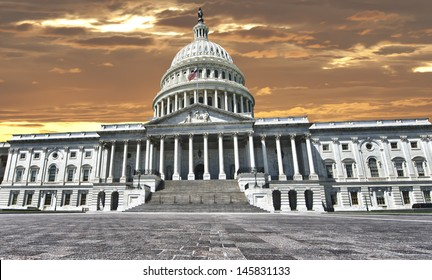 Huge view Panorama of Washington US Capitol on dramatic sunset gold sun sky background