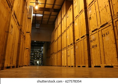 Huge Wall of Wooden Crates in Warehouse