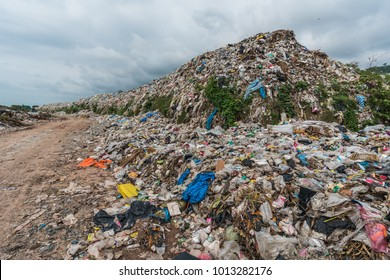 The huge waste pile extends into the garbage mountain .It has main component is plastic.That is product from the petrochemical industry.Plastic is a necessary and cheap packaging for food.