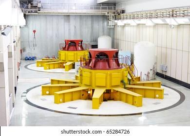 Huge water turbine generators. Hydroelectric power-plant. Interior