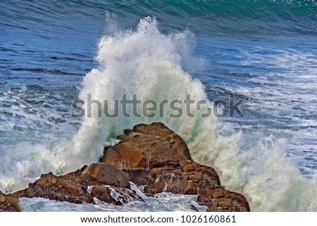 Huge wave breaking on rock. On the Big Sur coast, California USA.