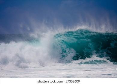 A huge wave is crashing on the beautiful Hawaii Oahu's North Shore