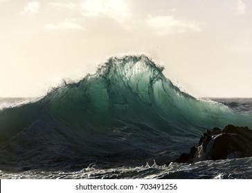 Huge wave at sunrise, Australia