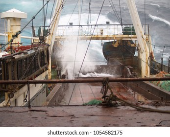 Huge waves shake a large bottom trawler caught in the midst of a storm in the North Atlantic