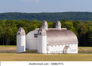 Huge white 19th Century barn with silos on the historic DH Day Farm in Michigan's Sleeping Bear Dunes National Lakeshore
