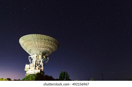 huge white satellite antenna radio telescope on the background of star