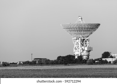 huge white satellite antenna radio telescope on the background of sky