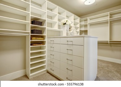 Huge white walk-in closet with shelves, drawers and shoe racks. Northwest, USA