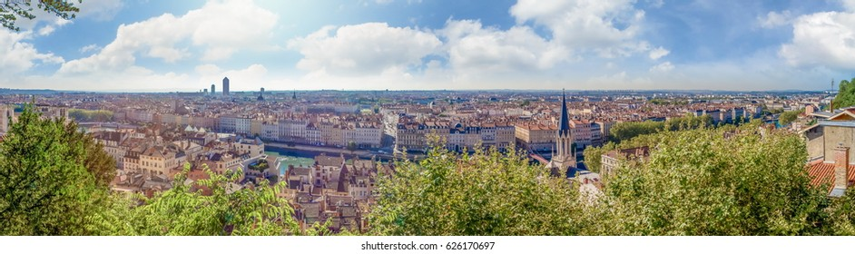 Huge wide Panorama summer view of the city, Lyon, France. With colorful blue sky and white clouds