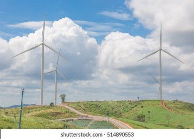 Huge wind turbine under clouds and blue sky, beautiful nature and Renewable power background