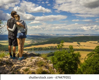 Hugging couple enjoying the view in Western Slovakia.