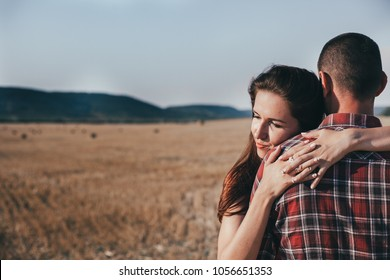 A hugging couple in love. Reliable rear and support in the form of a close person.