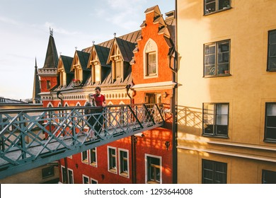 Hugging couple in love traveling together in Stockholm romantic vacations urban lifestyle architecture colorful houses european Sweden landmarks