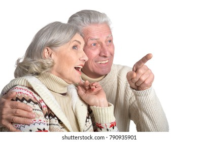 hugging senior couple pointing isolated