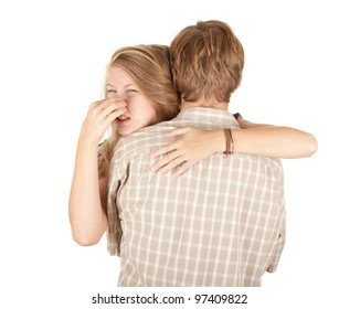 hugging woman and man, he smells hideously