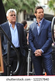 Hugh Jackman & Jay Leno (left) on Hollywood Blvd where Jackman was honored with the 2,487th star on the Hollywood Walk of Fame. December 13, 2012  Los Angeles, CA Picture: Paul Smith
