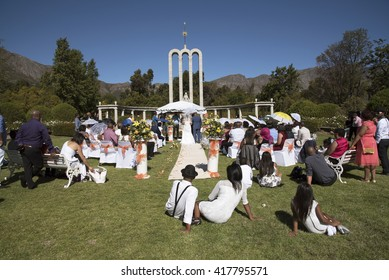 HUGUENOT MONUMENT FRANSCHHOEK WESTERN CAPE SOUTH AFRICA - APRIL 2016 - Bridge groom and guests at an African wedding in the Huguenot Monument garden in Franschhoek Southern Africa