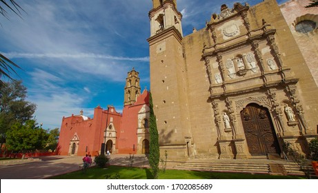 """Huichapan-Hidalgo, Mexico, december 22-2019. Lateral view of the """"Parroquia of San Mateo Apóstol, located to the right of the historic center,where there are two more churches located to the left."""
