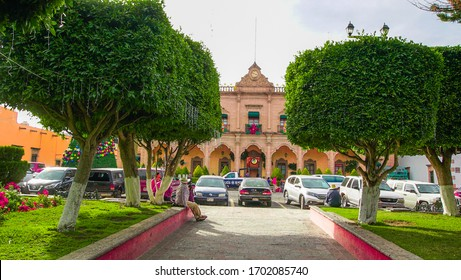 Huichapan-Hidalgo, Mexico, december 22-2019. Panoramic view of the building of the municipal presidency with a beautiful clock on the tip and his garden on the magical town of Huichapan.
