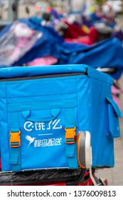 Huizhou, China - APR 2019: A take-out incubator on a hungry online ordering platform ELEME (ele.me, a subsidiary of Alibaba Group) is parked on an electric bike on the side of the road.
