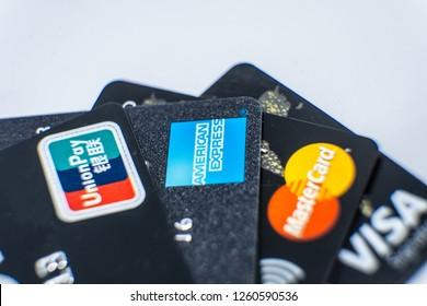 Huizhou, China - DEC 2018: Close up the credit cards with trademark logo of CHINA UNIONPAY, AMERICAN EXPRESS, MASTERCARD & VISA