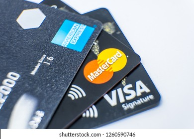 Huizhou, China - DEC 2018: Macro close up the credit cards with trademark logo of AMERICAN EXPRESS, MASTERCARD & VISA