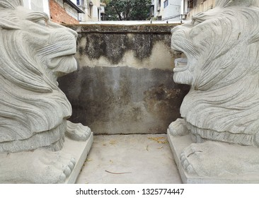 Huizhou, China - FEB 2019: Two abandoned stone lions were abandoned on the side of the road.