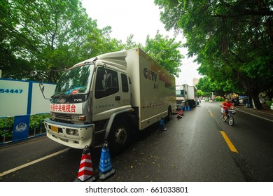 Huizhou, China - June 2017: The CCTV (China Central Television) broadcast truck on the Xizhi River bank waiting for prepare of China Longzhou Tournament