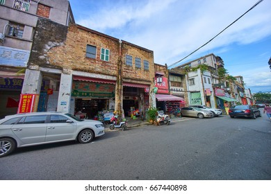 """Huizhou, China - June 2017: The street view of East Shuidong Road, as a famous old historial street have many arcade building """"Shuidong Street"""" in Huizhou old town, Guangdong Province."""
