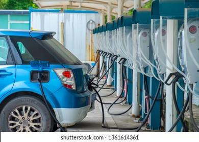 Huizhou, China - MAR 2019: The charging gun of the public charging pile of the electric taxi is charging the electric vehicle.