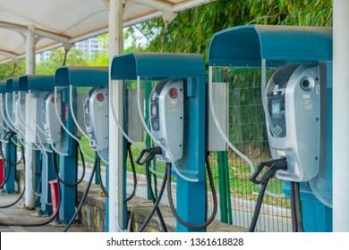 Huizhou, China - MAR 2019: Close up the charging gun and public charging pile