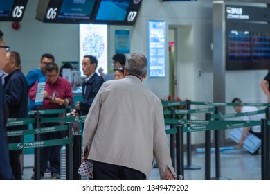 Huizhou, China - MAR 2019: The elder passenger waiting in line at the counter in the terminal of the Pingtan Airport in Huizhou to check in.