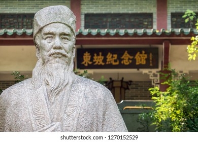 Huizhou, China - SEP 2017: The Su Dongpo's Statue and background is Su Dongpo Memorial Hall in Huizhou West Lake Scenic Spots Area