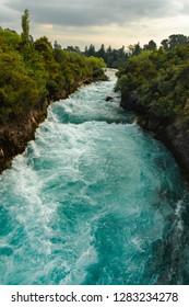 Huka Falls. The Huka Falls are a set of waterfalls on the Waikato River that drains Lake Taupo in New Zealand.