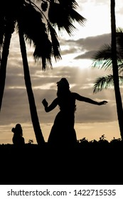 Hula dancer in front of sunset