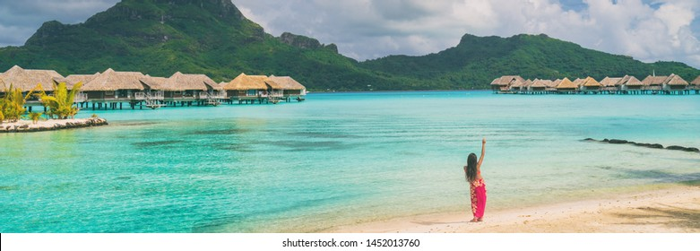 Hula dancer woman dancing at luau beach panoramic polynesian traditional dance. Tourist attraction activity at luxury resort, Tahiti.
