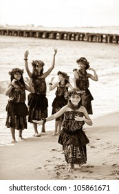 Hula girls on the beach processed in aged sepia