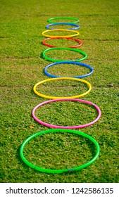 Hula hoops lying on the field.