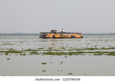 Hularhat, Bangladesh, February 27 2017: The Rocket - an ancient paddle steamer heads to Hularat pier on a river in Bangladesh.