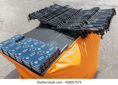 HULDA, ISRAEL - MAY 6:  Jewish Bibles and M16 assault rifles await distribution to new recruits of the Israel Defense Forces just before a swearing in ceremony near Hulda, Israel on May 9, 2016.
