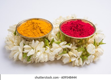 huldi kumkum or haldi-kumkum,indian hindu or punjabi woman applies on their forehead as an auspecious sign, also offered to god while prayer
