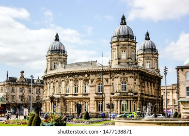 Hull, East Yorkshire/ United Kingdom - April 10 2019: building of Hull Maritime Museum and outdoor view of Hull city centre in spring 2019 with flowers and fontain. Cloudy sky, green grass a